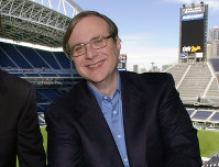 In this July 17, 2001 file photo, Seattle Seahawks owner Paul Allen appears in a suite in the team's stadium in Seattle. (AP Photo/Elaine Thompson)