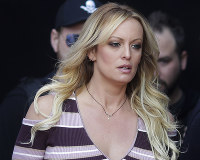 In this Oct. 11, 2018 photo, adult film actress Stormy Daniels arrives for the opening of the adult entertainment fair