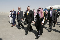 U.S. Secretary of State Mike Pompeo, second right in front, walks with Saudi Foreign Minister Adel al-Jubeir after arriving in Riyadh, Saudi Arabia, on Oct. 16, 2018. (Leah Millis/Pool Photo via AP)