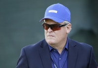 In this Oct. 12, 2014 file photo, broadcaster and Hall of Fame golfer Johnny Miller stands on the 18th green of the Silverado Resort North Course during the final round of the Frys.com PGA Tour golf tournament in Napa, California. (AP Photo/Eric Risberg)