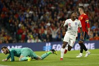 England's Raheem Sterling elebrates after scoring his side's third goal during the UEFA Nations League soccer match between Spain and England at Benito Villamarin stadium, in Seville, Spain, on 5, 2018. (AP Photo/Miguel Morenatti)