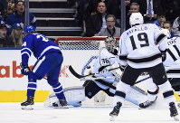 Toronto Maple Leafs right wing Kasperi Kapanen (24) scores on Los Angeles Kings goaltender Jack Campbell (36) during third period NHL hockey action in Toronto, Canada, on Oct. 15, 2018. (Nathan Denette/The Canadian Press via AP)