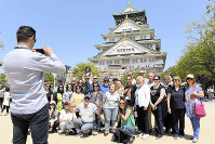Foreign tourists are seen at Osaka Castle Park in Osaka on Oct. 3, 2018, a month after Typhoon Jebi hit the region. (Mainichi/Kenji Ikai)
