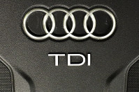 The Sept. 28, 2015 file photo shows the sign of German car company Audi attached on the engine of a TDI, a turbo diesel model, in Berlin, Germany. (AP Photo/Markus Schreiber)