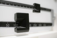 This April 3, 2018 file photo shows a close-up of a beam scale in New York. New research, published on Oct. 16 in the Journal of the American Medical Association, suggests obesity surgery may dramatically lower the danger of heart attacks and strokes in people with diabetes. (AP Photo/Patrick Sison)