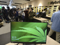 Members of the media attend a preview for one of Quebec's new cannabis stores in Montreal, on Oct.1 6, 2018. (Ryan Remiorz/The Canadian Press via AP)