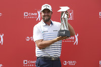 Marc Leishman of Australia poses with his trophy after winning the CIMB Classic golf tournament at Tournament Players Club (TPC) in Kuala Lumpur, Malaysia, on Oct. 14, 2018. (AP Photo/Vincent Phoon)