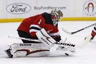 New Jersey Devils goaltender Keith Kinkaid (1) makes a save against the Dallas Stars in the first period of an NHL hockey game on Oct. 16, 2018, in Newark, N.J. (AP Photo/Adam Hunger)