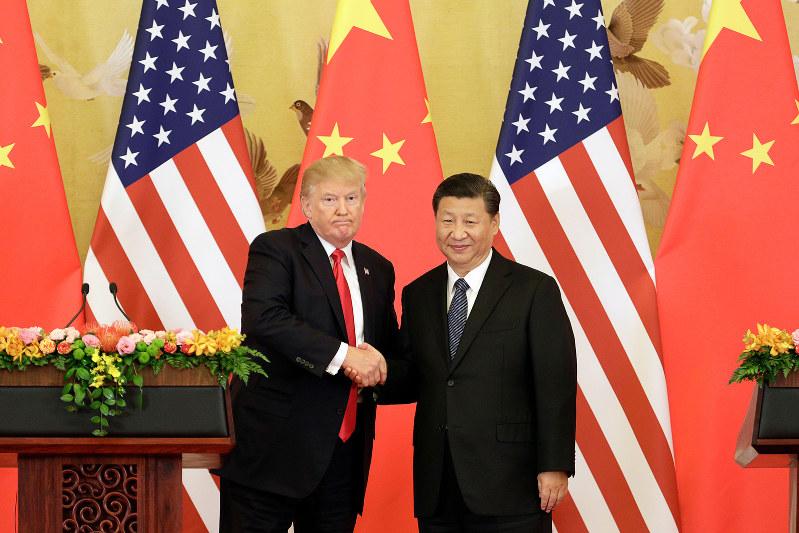 米中間覇権争いの中核がハイテク分野だ。トランプ米大統領と中国の習近平国家主席=北京