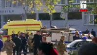 In this image made from video, showing the scene as emergency services load an injured person onto a truck, in Kerch, Crimea, on Oct. 17, 2018. (Kerch FM News via AP)