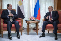 Russian President Vladimir Putin, right, and Egyptian President Abdel-Fattah el-Sisi talk during their meeting in Sochi, Russia, on Oct. 17, 2018. (AP Photo/Pavel Golovkin, Pool)