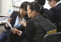 Keiko Fujimori, the daughter of Peru's former President Alberto Fujimori who is the leader of the opposition party, right, talks with her lawyer Giuliana Loza, during a hearing to appeal her detention in Lima, Peru, Wednesday, Oct. 17, 2018. An appeals judge has freed Keiko Fujimori a week after she was arrested during a money laundering investigation. (AP Photo/Martin Mejia)