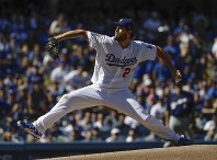 Los Angeles Dodgers starting pitcher Clayton Kershaw throws during the first inning of Game 5 of the National League Championship Series baseball game against the Milwaukee Brewers on Oct. 17, 2018, in Los Angeles. (AP Photo/Matt Slocum)