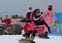 Snowboarders wearing costumes are seen at the ski resort