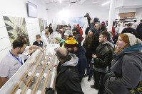 People check out the sample counter at a cannabis store in Winnipeg, Manitoba, on Oct. 17, 2018. Canada became the largest country with a legal national marijuana market. (John Woods/The Canadian Press via AP)