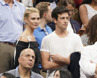 In this Sept. 6, 2018 file photo, Karlie Kloss, top left, and Joshua Kushner attend the semifinals of the U.S. Open tennis tournament at the USTA Billie Jean King National Tennis Center in New York. (Photo by Greg Allen/Invision/AP,)