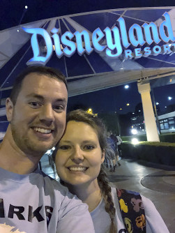 This Oct. 17, 2018 photo provided by Clark Ensminger, shows him with his wife Heather Ensminger at Disneyland in Anaheim, Calif. (Clark Ensminger via AP)