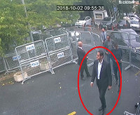 Caption In a frame from surveillance camera footage taken Oct. 2, 2018, and published on Oct. 18, 2018, by the pro-government Turkish newspaper Sabah, a man identified by Turkish officials as Maher Abdulaziz Mutreb, walks toward the Saudi Consulate in Istanbul before writer Jamal Khashoggi disappeared. (Sabah via AP)