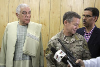 Kandahar Gov. Zalmay Wesa, left, stands with the head of NATO troops in Afghanistan, Gen. Scott Miller, center, and a translator, during a meeting, in Kandahar, Afghanistan, on Oct. 18, 2018. (AP Photo)