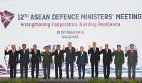 Defense Ministers from left to right, Brunei's Second Minister, Brunei, Halbi Nin Haji Mohd Yusof, Cambodia's Samdech Pichey Sena Tea Banh, Indonesia's General Ryamizard Ryacudu, Laos' Lieutenant-General Chansamone Chanyalath, Malaysia's Haji Mohamad Bin Sabu, Singapore's Ng Eng Hen, Thai General Prawit Wongsuwon, Myanmar's Lieutenant-General Sein Win, Philippines' Delfin N. Lorenzana, Vietnam's General Ngo Xuan Lich and ASEAN Deputy Secretary General Hoang Anh Tuan during a group photo for the ASEAN Defense Ministers' Meeting in Singapore on Oct. 19, 2018. (AP Photo/Don Wong)