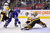Toronto Maple Leafs centre Zach Hyman (11) is stopped by Pittsburgh Penguins goaltender Matt Murray (30) as Pittsburgh Penguins left wing Carl Hagelin (62) defends during the second period of an NHL hockey game on Oct. 18, 2018. (Frank Gunn/The Canadian Press via AP)