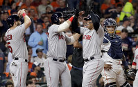Boston Red Sox's Rafael Devers, right, celebrates his three-run home run against the Houston Astros during the sixth inning in Game 5 of Major League Baseball's American League Championship Series on Oct. 18, 2018, in Houston. (AP Photo/David J. Phillip)