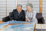 Emperor Akihito and Empress Michiko look at a map of Japan with blue and red pins marking the places they have visited, at the Imperial Palace in Tokyo's Chiyoda Ward, on Oct. 10, 2018. (Photo courtesy of the Imperial Household Agency)