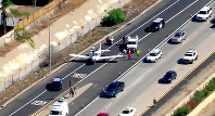 This photo taken from video provided by fox5sandiego.com shows a small plane after it made an emergency landing in the westbound lanes of Interstate 8 in El Cajon, Calif., east of San Diego, on Oct. 19, 2018 (fox5sandiego.com via AP)