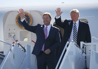 President Donald Trump arrives with Sen. Dean Heller, R-Nev., on Air Force One at Elko Regional Airport, Saturday, Oct. 20, 2018, in Elko, Nv., for a campaign rally. (AP Photo/Carolyn Kaster)