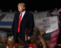 President Donald Trump looks at the cheering audience as he leaves a campaign rally at Minuteman Aviation Hangar, Thursday, Oct. 18, 2018, in Missoula, Mont. (AP Photo/Carolyn Kaster)