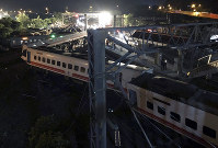 This photo released by Military News Agency shows a general view at the site of a train derailment in Lian in northern Taiwan on  Oct. 21 2018. (Taiwan Railways Administration via AP)