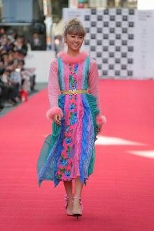 Pop singer Dream Ami walks on a specially prepared runway on a street in the Shibuya district of Tokyo on Oct. 21, 2018. (Mainichi/Daisuke Wada)