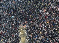 People take part in a rally of PEGIDA (Patriotic Europeans against the Islamization of the West) in Dresden, Germany, Sunday, Oct.21, 2018. (AP Photo/Jens Meyer)