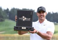 Brooks Koepka of the United States poses with his trophy after winning the CJ Cup PGA golf tournament at Nine Bridges on Jeju Island, South Korea, on Oct. 21, 2018. (Park Ji-ho/Yonhap via AP)