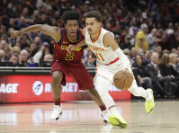 Atlanta Hawks' Trae Young (11) drives past Cleveland Cavaliers' Collin Sexton (2) in the second half of an NBA basketball game, on Oct. 21, 2018, in Cleveland. The Hawks won 133-111. (AP Photo/Tony Dejak)