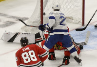 Tampa Bay Lightning center Brayden Point (21) scores against the Chicago Blackhawks during the second period of an NHL hockey game on Oct. 21, 2018, in Chicago. (AP Photo/Matt Marton)