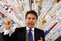 Italian Premier Giuseppe Conte answers reporters' questions during a press conference at the foreign press club in Rome, on Oct. 22, 2018. (AP Photo/Gregorio Borgia)