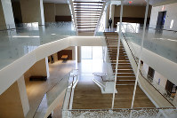 In this Oct. 30, 2017 photo, security workers stand inside a large open stairwell area at the Museum of the Bible in Washington. (AP Photo/Jacquelyn Martin)