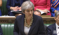 In this image taken from Parliament TV, Britain's Prime Minister Theresa May makes a statement to the House of Commons about the European Council summit, in London, on Oct. 22, 2018. (Parliament TV via AP)
