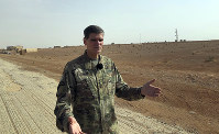 U.S. Gen. Joseph Votel, top U.S. commander in the Middle East, speaks to reporters during an unannounced visit to the al-Tanf military outpost in southern Syria, on Oct. 22, 2018. (AP Photo/Lolita Baldor)