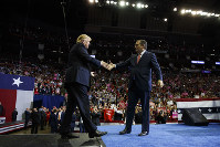 U.S. President Donald Trump is greeted by Sen. Ted Cruz, R-Texas, as he arrives for a campaign rally at Houston Toyota Center on Oct. 22, 2018, in Houston. (AP Photo/Evan Vucci)