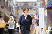 Hong Jung-sook walks the streets of Osaka's bustling Koreatown filled with young people, in this photo taken on Aug. 25, 2018. (Mainichi/Yusuke Komatsu)