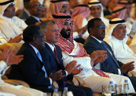 Saudi Crown Prince, Mohammed bin Salman, center, and Jordan's King Abdullah II second left, attend the Future Investment Initiative conference, in Riyadh, Saudi Arabia, on Oct. 23, 2018. (AP Photo/Amr Nabil)