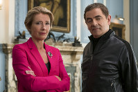 This image released by Focus Features shows Emma Thompson, left, and Rowan Atkinson in a scene from