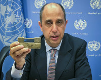 Tomas Ojea Quintana, the United Nations special investigator on human rights in North Korea, holds up a lock given to him by North Koreans who escaped from the country, during a press conference, on Oct. 23, 2018, at U.N. headquarters in New York. (AP Photo/Edith M. Lederer)