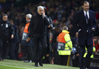 ManU coach Jose Mourinho, center, and Juventus coach Massimiliano Allegri, right, leave the field at the end of the Champions League group H soccer match between Manchester United and Juventus at Old Trafford, Manchester, England, on Oct. 23, 2018. (AP Photo/Dave Thompson)