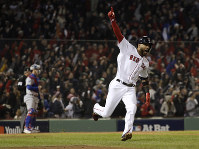 Boston Red Sox's Eduardo Nunez reacts after hitting a three-run home run during the seventh inning of Game 1 of the World Series baseball game against the Los Angeles Dodgers on Oct. 23, 2018, in Boston. (AP Photo/David J. Phillip)