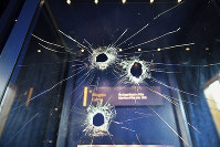 Hammer holes are seen in the glass case that housed the Magna Carta at Salisbury Cathedral after a 45-year-old man has been arrested on suspicion of its attempted theft, in Salisbury, England, on Oct. 26, 2018. (Ben Birchall/PA via AP)