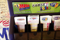 In this Tuesday, Oct. 23, 2018 file photo, lottery forms for Louisiana Mega Millions, Powerball and other lottery games fill the drawer at The World Bar and Grill, in Delta, La., a few miles from the Mississippi-Louisiana state line. (AP Photo/Rogelio V. Solis)
