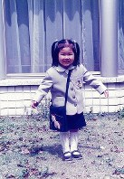 Princess Ayako is seen wearing a kindergarten uniform in her residence in Tokyo's Minato Ward on April 10, 1994. (Photo courtesy of the Imperial Household Agency)
